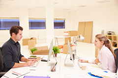 Businesspeople Working At Desks In New Office Royalty Free Stock Images