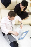 Businesspeople working on laptop Stock Photography