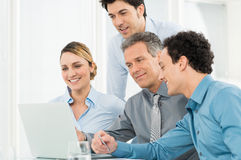 Businesspeople Working At Laptop Stock Photo