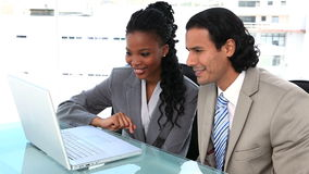 Businesspeople working with a laptop. In a office stock video footage