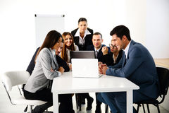 Businesspeople working on laptop Stock Image