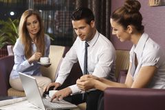 Businesspeople working late on business trip Stock Photography