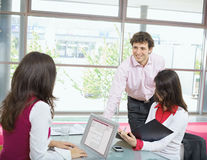 Businesspeople working in office Stock Image