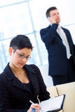 Businesspeople working at office Stock Images