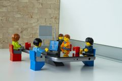 Businesspeople working in office. Alcobendas, Madrid, Spain. March 9, 2018. Businesspeople working in office, Lego minifigures are manufactured by The Lego Group Stock Photo