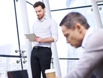 Businesspeople working in office Stock Images