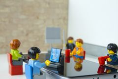 Businesspeople working in office, focus in the workers. Alcobendas, Madrid, Spain. March 9, 2018. Businesspeople working in office, Lego minifigures are royalty free stock image