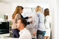 Businesspeople working in office stock photography