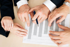 Businesspeople Working On Charts And Graphs Stock Images