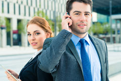 Businesspeople working outdoor Stock Images