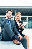Businesspeople working outdoor Stock Photos