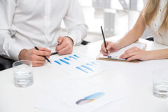 Businesspeople working on report Royalty Free Stock Photography