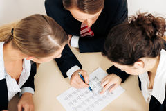 Businesspeople working on spreadsheet Stock Images