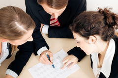 Businesspeople working on spreadsheet Royalty Free Stock Image