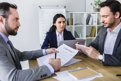 Businesspeople working at table. In modern office royalty free stock image