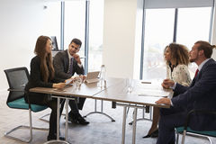 Businesspeople Working Together At Desk In Modern Office Royalty Free Stock Images