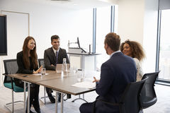 Businesspeople Working Together At Desk In Modern Office Stock Images