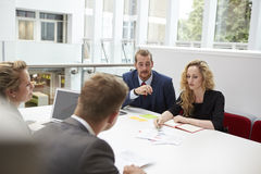 Businesspeople Working Together At Desk In Modern Office Stock Photos