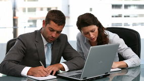 Businesspeople working together on a laptop. In a office stock video