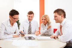 Businesspeople working together at meeting table in office Stock Photography