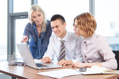 Businesspeople working together at meeting table in office Royalty Free Stock Image