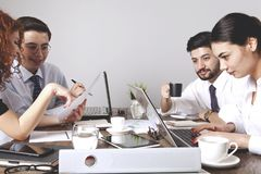 Businesspeople working together in office. stock photos