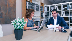 Businesspeople working together at table in office Stock Image