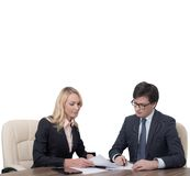 Businesspeople working. Two businesspeople working in office isolated on white stock images