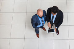 Businesspeople Working Using Tablet Computer, Two Business Man Standing Stock Images