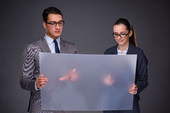 The businesspeople working on virtual screen. Businesspeople working on virtual screen Stock Photography