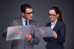 The businesspeople working on virtual screen. Businesspeople working on virtual screen Stock Image