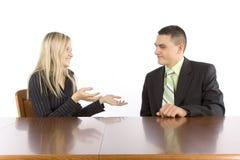 businesspeoplekonversation två arkivfoton
