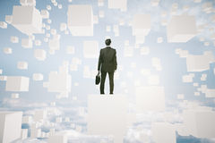 Businessperson on abstract cube. Businessman with briefcase on abstract white cubes in the sky looking into the distance. Research concept. 3D Rendering Stock Photography