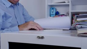 Businessperson in accounting archive working with documents stock video