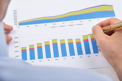 Businessperson Analyzing Graphs Stock Photos