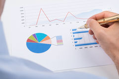 Businessperson Analyzing Statistic Chart Stock Photos