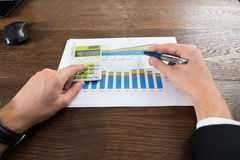 Businessperson Analyzing Statistical Data Stock Images