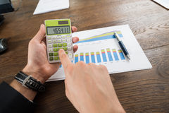 Businessperson Analyzing Statistical Data Royalty Free Stock Photos