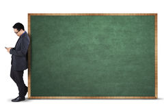 Businessperson and blank chalkboard Royalty Free Stock Photo