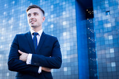 Businessperson and blue skyscraper Stock Photography