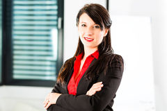 Businessperson in business office Royalty Free Stock Photography