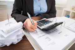 Businessperson calculating bills Royalty Free Stock Images