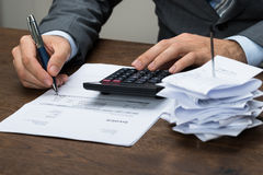 Businessperson calculating financial expenses Stock Image