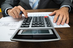 Businessperson calculating financial sheet Stock Images