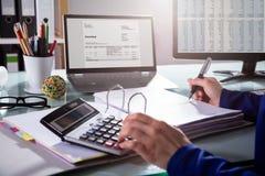Businessperson Calculating Invoice royaltyfri fotografi