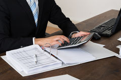 Businessperson Calculating Invoice In Office Royalty Free Stock Photos