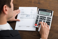 Businessperson Calculating Tax In Office Royalty Free Stock Photo