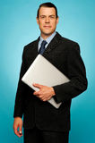 Businessperson carrying a laptop Stock Photo