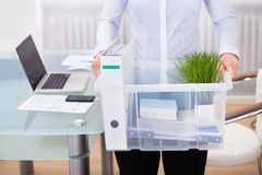 Businessperson carrying office supply Stock Photo