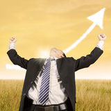 Businessperson celebrate his winning outdoors Stock Images